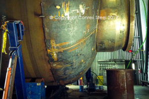 Conventional tank head welded on a pressure vessel