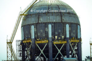 Final sphere assembly in field of legs, stubs, and safety railing
