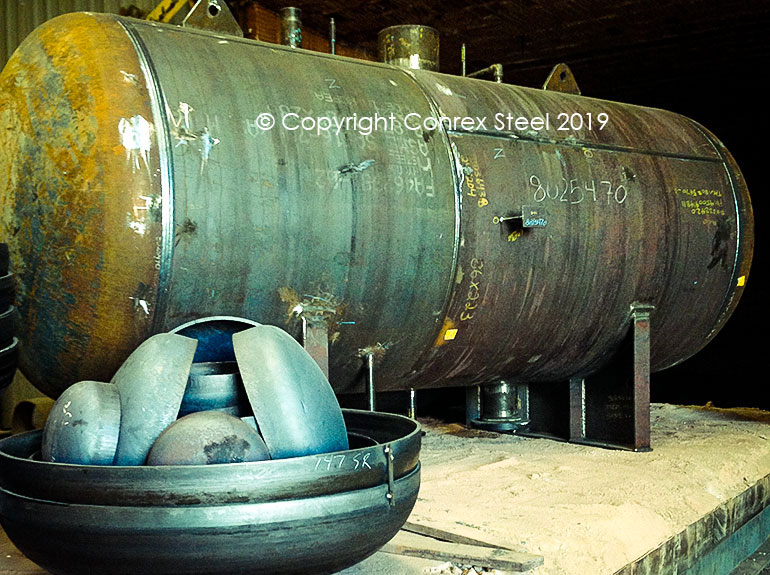 Post weld heat treatment of pressure vessel and conventional heads